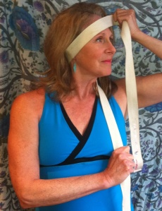 holistic health tip yoga strap neck